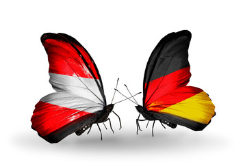 Two butterflies with flags Austria and Germany
