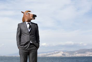 Horse head businessman