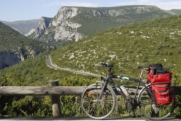 Gorges du Verdon and bicycle with red bags