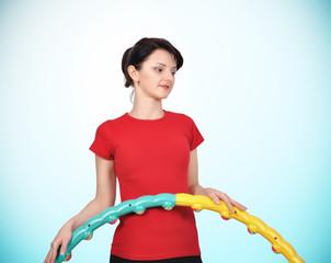 girl holding color hula hoop