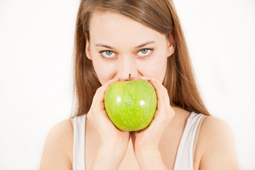 A young beautiful woman with a green apple