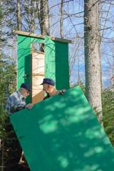 Seniors framing an hunter cabin.