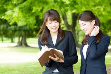 asian businesswomen working in the park