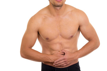 muscular shirtless man with stomach pain