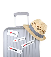 Travel suitcase and hat isolated on white