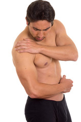 muscular shirtless man with shoulder pain