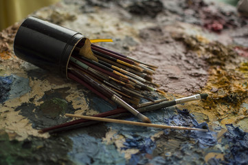 Brushes for painting on palette of dry oil colors