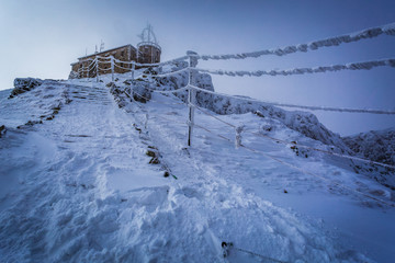 Weather station in the mountains in winter
