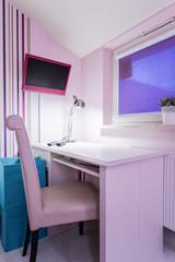 Pink furniture inside room
