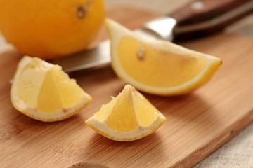 Fresh lemon on a cutting board.
