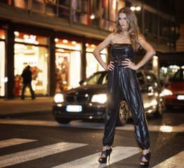Model standing on pedestrian crossing