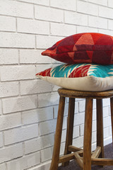 Homewares decorator cushions on a wooden stool