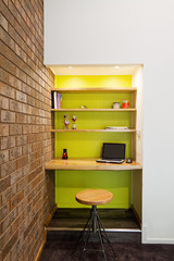 Lime green feature wall study nook in living room