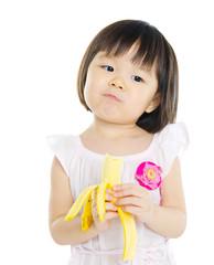 Asian girl eating banana