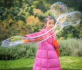 Asian girl play a bubble