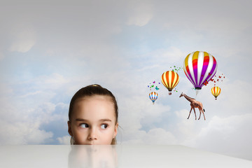 Giraffe flying on balloons