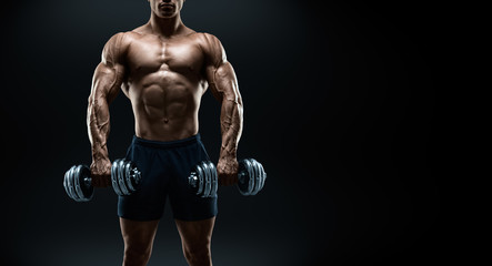 Strong and power bodybuilder doing exercises with dumbbells
