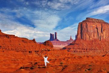 "Woman in white performs asana ""Tree"""