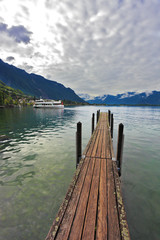 Boat wooden pier on Lake Leman