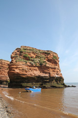 Sandstone cliffs and pillars at Ladram Bay in Devon