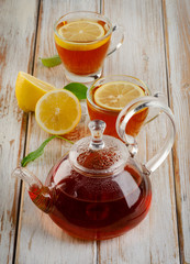 Healthy hot  tea and lemon on  a wooden table