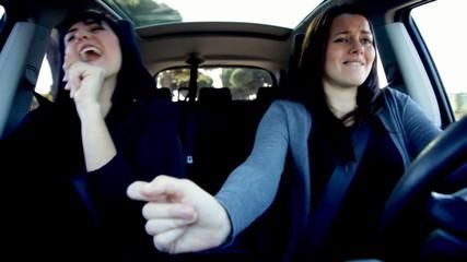 Happy women driving car having fun