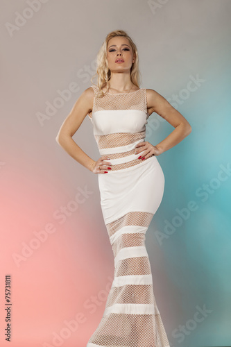 canvas print picture young woman in an elegant white dress posing in studio