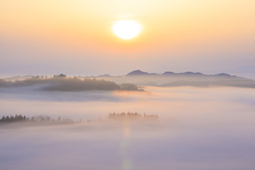 Sunrise from sea of clouds