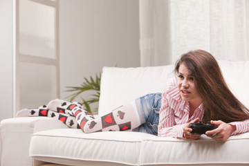 pretty girl playing videogames at home
