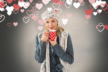 Woman in winter fashion looking at camera with mug