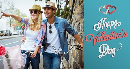 Hip young couple standing by brick wall with their bikes