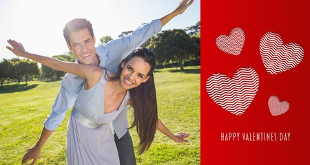 Composite image of happy couple with arms outstretched at park