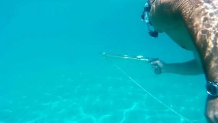 Diver with underwater gun
