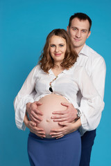 a man with a pregnant woman