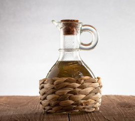 bottle with braided filled with olive oil