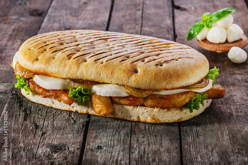 grilled sandwich with chicken and mozzarella cheese - 75734882