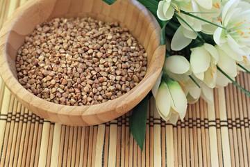 buckwheat grain in a wooden bowl