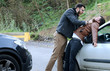 Leinwanddruck Bild - businessman strikes a man after having had an accident
