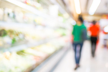 Blur background of woman customer select fresh product on shelf