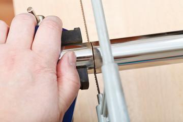 metalworker saws metal pipe close up