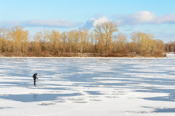 Fisherman on the Frozen River
