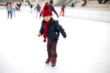 Happy boy with red hat, skating during the day
