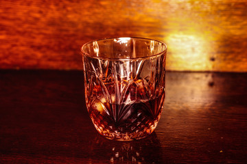 Whiskey drink on wooden table