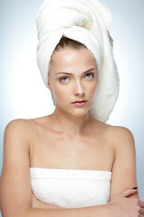 Portrait of beautiful woman with fresh skin after bath