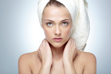 Closeup portrait of young beautiful woman after bath