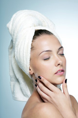 woman with perfect skin and towel on head