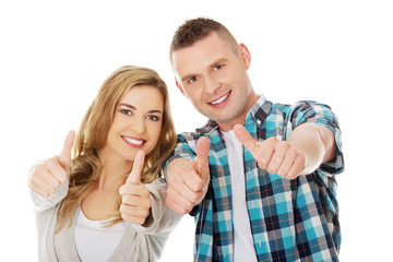 Couple showing thumbs up