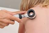 Dermatologist examines child patient birthmark poster