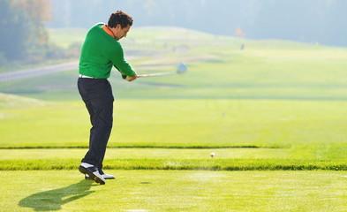 Golfer swing, teeing off on beautiful summer morning