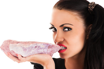 beauty hungry woman eating raw meat in hand